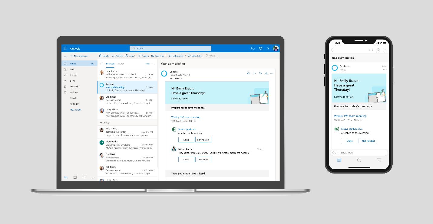 E-Mail Programm Microsoft Outlook auf einem Laptop und einem Smartphone